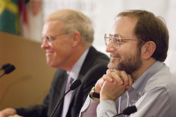 Stanford President John Hennessy (L) and Nobel Laureate Andrew Fire attend a press conference after the announcement of the Nobel Prize in Physiology or Medicine Oct. 2, 2006 in Stanford, California. (Linda A.Cicero/Stanford News via Getty Images)
