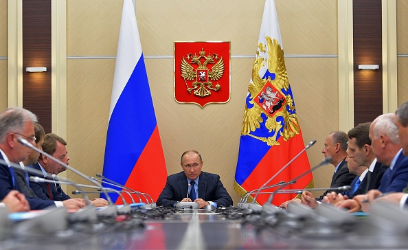 Russian President Vladimir Putin chairs the Commission on military-technical cooperation with foreign states in his residence in Novo-Ogaryovo, outside Moscow, on July 6, 2017.(ALEXEY DRUZHININ/AFP/Getty Images)