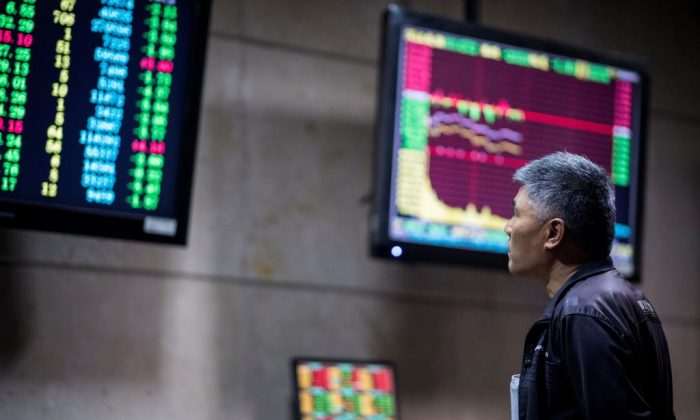 An investor monitors stock prices at a securities company in Shanghai on May 30, 2018. (Johannes Eisele/AFP/Getty Images)