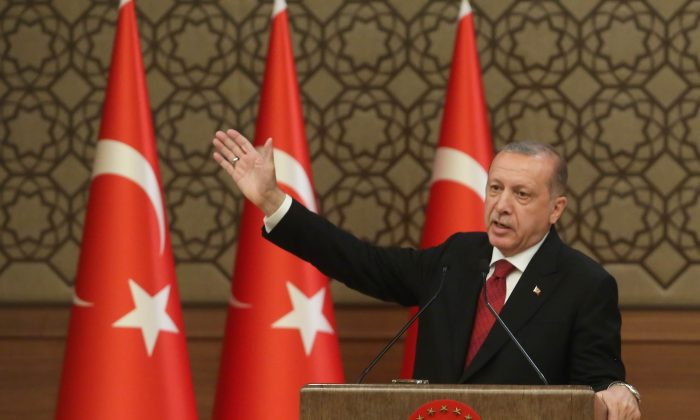 Turkey's President Tayyip Erdogan announces the new ministers of his cabinet during a press conference at the Presidential Palace in Ankara, Turkey on July 9, 2018. (Stringer/Getty Images)