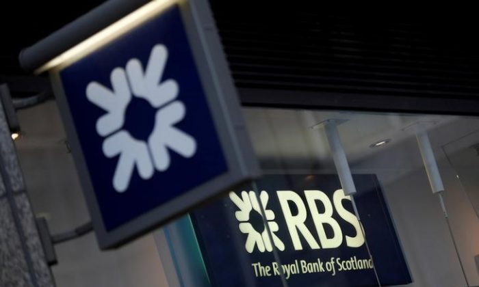 Royal Bank of Scotland signs are seen at a branch of the bank, in London, Britain Dec. 1, 2017. (Reuters/Peter Nicholls)