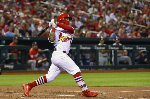 Cardinals second baseman Kolten Wong hits a two run double against Washington Nationals starting pitcher Gio Gonzalez during the fourth inning.