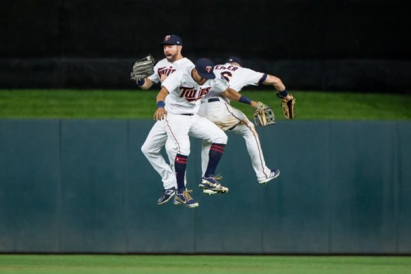 Minnesota Twins outfielder Jake Cave, outfielder Eddie Rosario and outfielder Max Kepler celebrate after the game against Pittsburgh Pirates.
