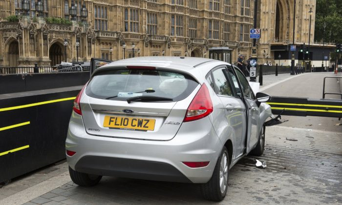 The car that was driven at pedestrians and cyclists in Westminster then crashed into the barrier outside the Houses of Parliament on Tuesday is seen in an image handed out by the Metropolitan Police in London, Aug. 15, 2018. (Metropolitan Police handout via Reuters)