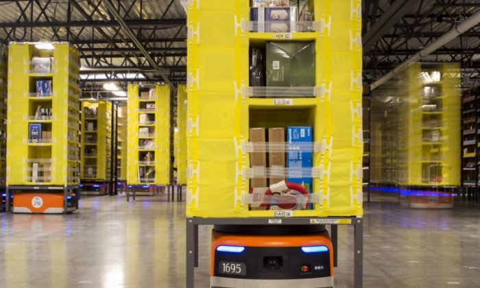 Kiva robots move inventory at an Amazon fulfillment center.(Reuters/Noah Berger)