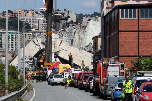 Rescue crews at the site of the Morandi bridge disaster