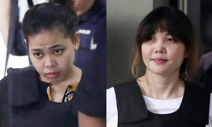 Indonesian Siti Aisyah, left, and Vietnamese Doan Thi Huong, right, escorted by police as they leave a court hearing in Shah Alam, Malaysia, outside Kuala Lumpur on Oct. 2, 2017. Two Southeast Asian women on trial in Malaysia for the brazen assassination of the North Korean leader's half-brother could be acquitted on Aug. 16, 2018, or called to enter their defense in a case that has gripped the world. (AP Photo/Daniel Chan, File)