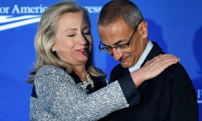 Then Secretary of State Hillary Clinton and John Podesta, who would became her campaign chairman during the 2016 elections, in Washington D.C. on Oct. 12, 2011. (Chip Somodevilla/Getty Images)