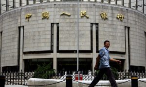 People's Bank of China Cuts Foreign Exchange Assets by a Third