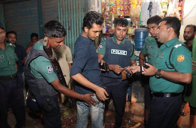 Police search a man during an anti drug raid in Dhaka, Bangladesh, June 4, 2018. (REUTERS/Salahuddin Ahmed)