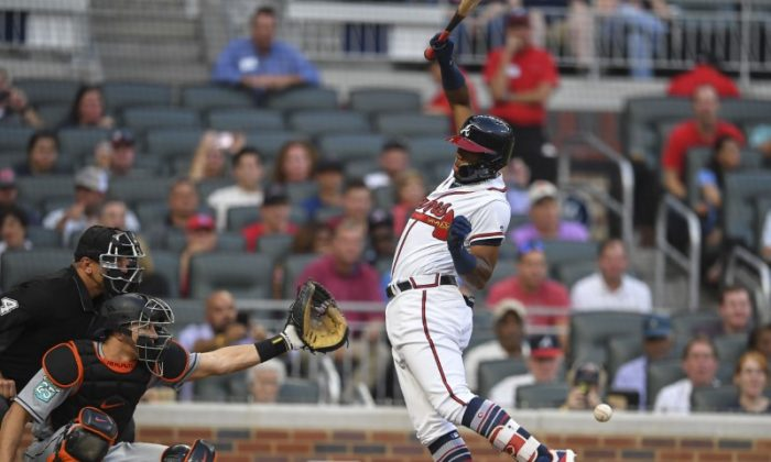 Atlanta Braves Ronald Acuna Jr. is hit by a 97 mph fastball on the first pitch of the game against the Miami Marlins during the first inning at SunTrust Park. (Dale Zanine/USA Today Sports)