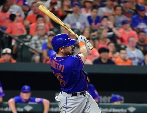 New York Mets catcher Kevin Plawecki hits a grand slam in the sixth inning against the Baltimore Orioles.