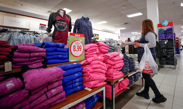 A shopper checks on merchandise at the J.C. Penney department store in North Riverside, Illinois on Nov. 17, 2017. (REUTERS/Kamil Krzaczynski)