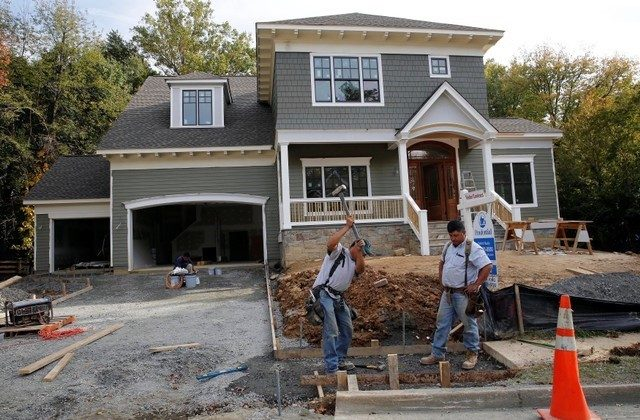 Construction workers are pictured building a new home in Vienna, Virginia, outside of Washington, Oct. 20, 2014. (Reuters)