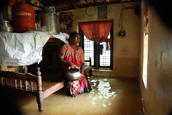 An Indian woman sits inside her houses immersed in flood waters in Ernakulam district of Kochi, in the Indian state of Kerala on Aug. 10, 2018. (AFP/Getty Images)