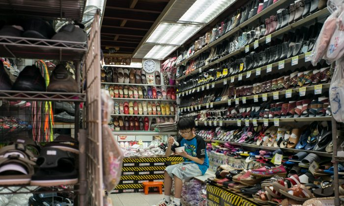 A boy at a shoe shop in a market in Hong Kong on July 6, 2016.   (Anthony Wallace/AFP/Getty Images)