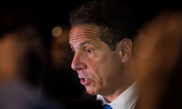Gov. Andrew Cuomo speaks to the press during the New York Democratic convention at Hofstra University on May 23, 2018 in Hempstead, New York. (Kevin Hagen/Getty Images)