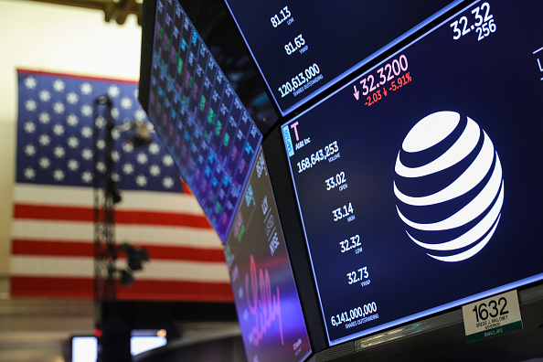 A logo and trading information for AT&T is displayed on a monitor on the floor of the New York Stock Exchange (NYSE) June 13, 2018 in New York City. (Drew Angerer/Getty Images)
