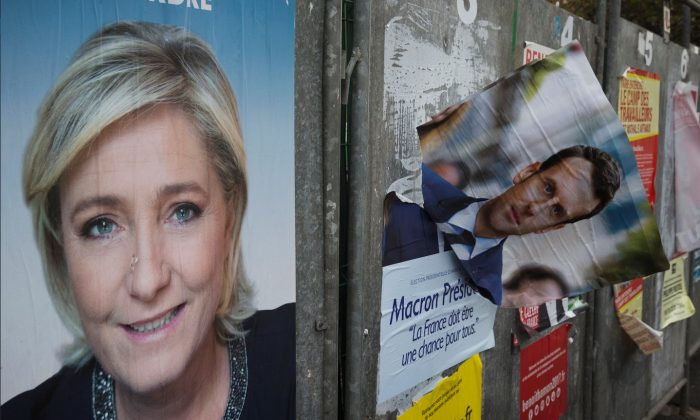 Marine Le Pen, a prominent figure on the political far-right in France, has been cut from the roster of speakers at the tech event Web Summit. Le Pen is featured on a campaign poster in Henin-Beaumont, France on April 24, 2017. (Joel Saget/AFP/Getty Images)