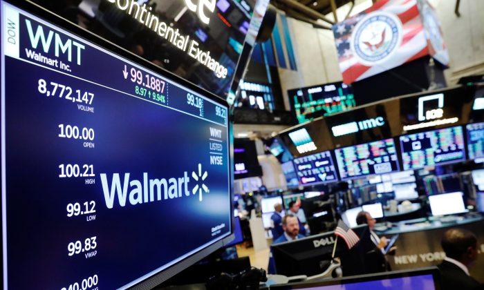 A Walmart logo above the floor of the New York Stock Exchange shortly after the opening bell on Aug. 16, 2018. REUTERS/Lucas Jackson