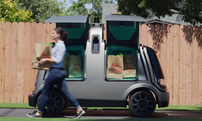 Nuro's R1 driverless delivery van  packed with bags from Kroger's Fry's Food Stores, which will begin a test of the vehicle in Scottsdale, Ariz., his autumn on Aug. 15, 2018. Courtesy of Kroger/Handout via REUTERS
