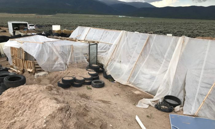 The compound where 11 children were taken in protective custody after a raid by authorities near Amalia, New Mexico, Aug. 10, 2018. (Andrew Hay/Reuters)