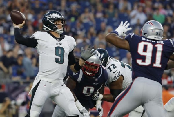 Philadelphia Eagles quarterback Nick Foles throws a pass against the New England Patriots in the first quarter.
