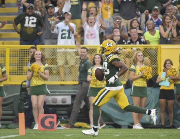 Green Bay Packers cornerback Tramon Williams returns an interception for a touchdown in the first quarter against the Pittsburgh Steelers.