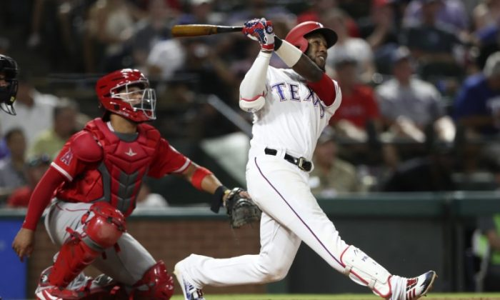 Texas Rangers third baseman Jurickson Profar hits a home run during the sixth inning against the Los Angeles Angels. (Kevin Jairaj/USA Today Sports)