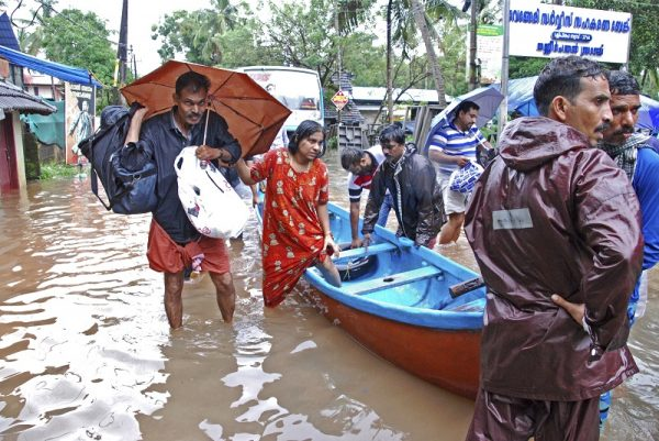 Torrential monsoon rains have disrupted air and train services in the southern Indian state of Kerala.