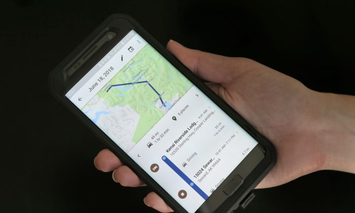 A mobile phone displays a user's travels using Google Maps in New York. (AP Photo/Seth Wenig, File)