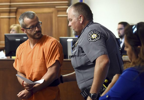 Chris Watts glances back at a Weld County Sheriff's Deputy as he is escorted out of the courtroom on Aug. 16, 2018, at the Weld County Courthouse in Greeley, Colo. (Joshua Polson/The Greeley Tribune/AP)