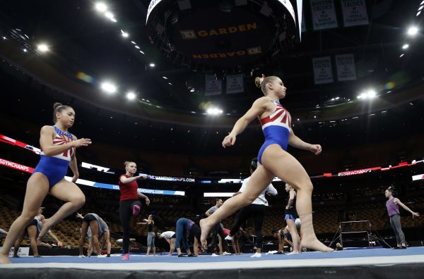 Ragan Smith warms up with other athletes during a training session at the U.S. Gymnastics Championships in Boston. (AP/Elise Amendola)