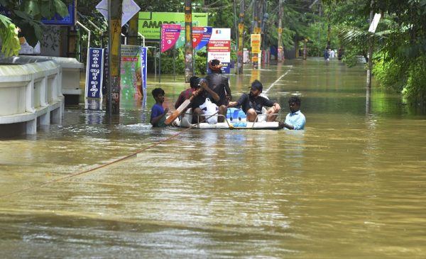 Rescuers used helicopters and boats on Aug. 17, 2018, to evacuate thousands of people stranded on their rooftops following unprecedented flooding in the southern Indian state of Kerala that left more than 100 dead.