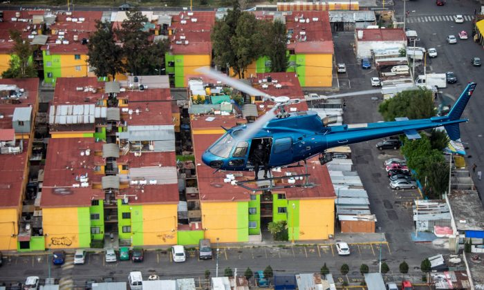 A helicopter of the police Condor group overflies Mexico City on Aug. 2, 2018.     PEDRO PARDO/AFP/Getty Images