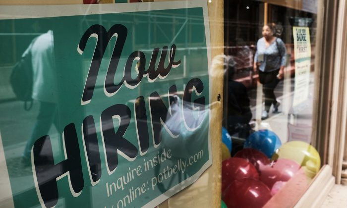 A store advertises that they are hiring in lower Manhattan on June 1, 2018. (Spencer Platt/Getty Images)