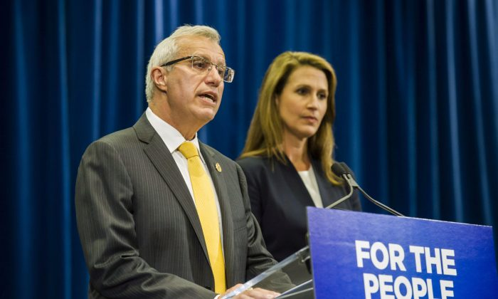 Ontario's Minister of Finance Vic Fideli and Attorney General Caroline Mulroney deliver remarks following an announcement on the provinces's cannabis retail model, in Toronto on Aug. 13, 2018. (THE CANADIAN PRESS/Christopher Katsarov)