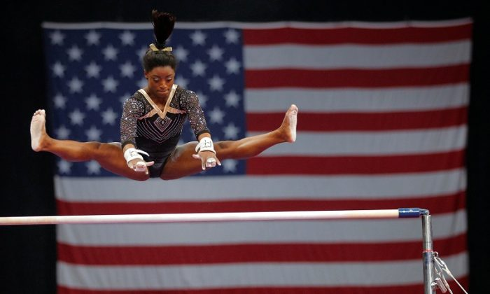 Simone Biles competes on the uneven bars at the U.S. Gymnastics Championships in Boston, Mass., Aug. 17, 2018. (Reuters/Brian Snyder)