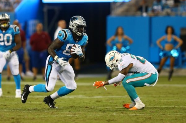 Carolina Panthers tight end Ian Thomas runs after a catch while Miami Dolphins defensive back Maurice Smith attempts to the tackle in the third quarter.