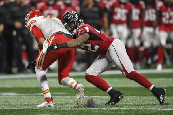Atlanta Falcons linebacker Duke Riley tackles Kansas City Chiefs quarterback Patrick Mahomes during the first half.