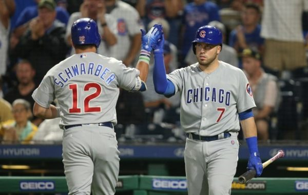 Chicago Cubs catcher Victor Caratini greets left fielder Kyle Schwarber crossing home plate with a solo home run against the Pittsburgh Pirates.