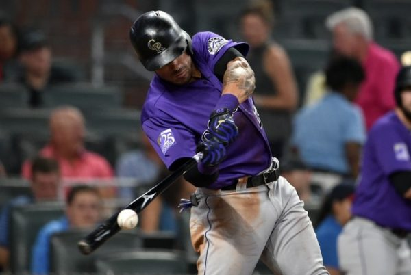 Colorado Rockies first baseman Ian Desmond hits an RBI against the Atlanta Braves during the eighth inning.