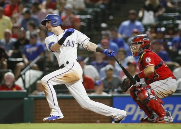 Texas Rangers center fielder Carlos Tocci singles in the seventh inning against the Los Angeles Angels.