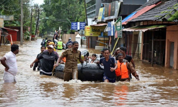 Rescuers evacuate people from a flooded area to a safer place in Aluva in the southern state of Kerala, India on August 18, 2018. (Sivaram V/REUTERS)