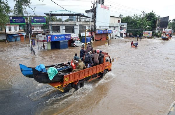 A supply truck transporting boats to flooded areas moves through a water-logged road in Aluva in the southern state of Kerala, India on August 18, 2018. (Sivaram V/REUTERS)