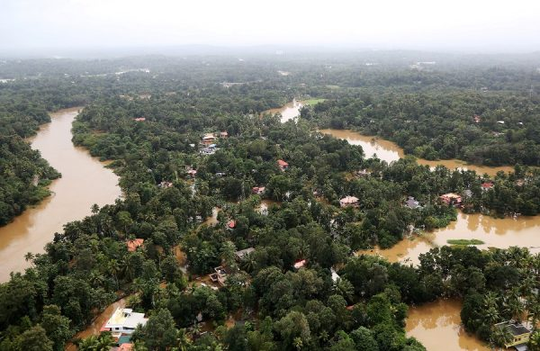 An aerial view shows partially submerged houses at a flooded area in the southern state of Kerala, India on August 17, 2018. (Sivaram V/REUTERS)