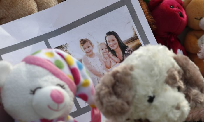 A photograph sits amid the tributes as they grow outside the home where a pregnant woman, Shanann Watts, and her two daughters, Bella and Celeste, lived in Frederick, Colorado, on Aug. 16, 2018,  (David Zalubowski/AP Photo)