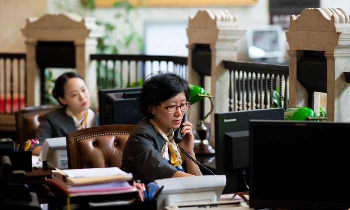 Employees work at a bank in Shanghai on Aug. 8, 2018. (Johannes Eisele / AFP/Getty Images)
