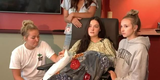 Jordan Holgerson sitting in a wheel chair with her friends beside her, in a file photo. (Screenshot/Fox)