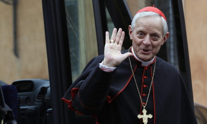 FILE PHOTO: Cardinal Donald William Wuerl from U.S. waves as he arrives for a meeting at the Synod Hall in the Vatican March 7, 2013. (Reuters/Alessandro Bianchi)